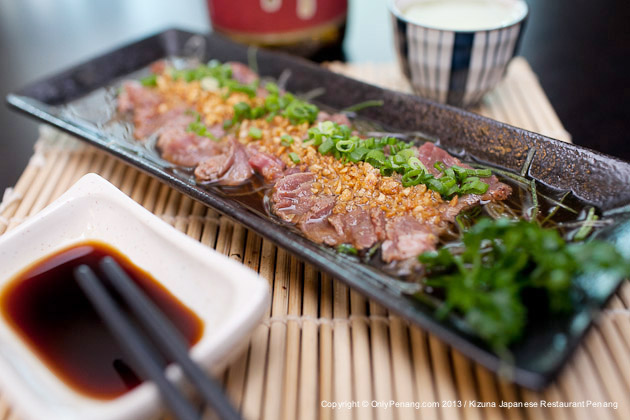 Kizuna Beef Tataki, 90% raw, thin-sliced Sirloin Beef is served cold with lemonly-taste Ponzu sauce